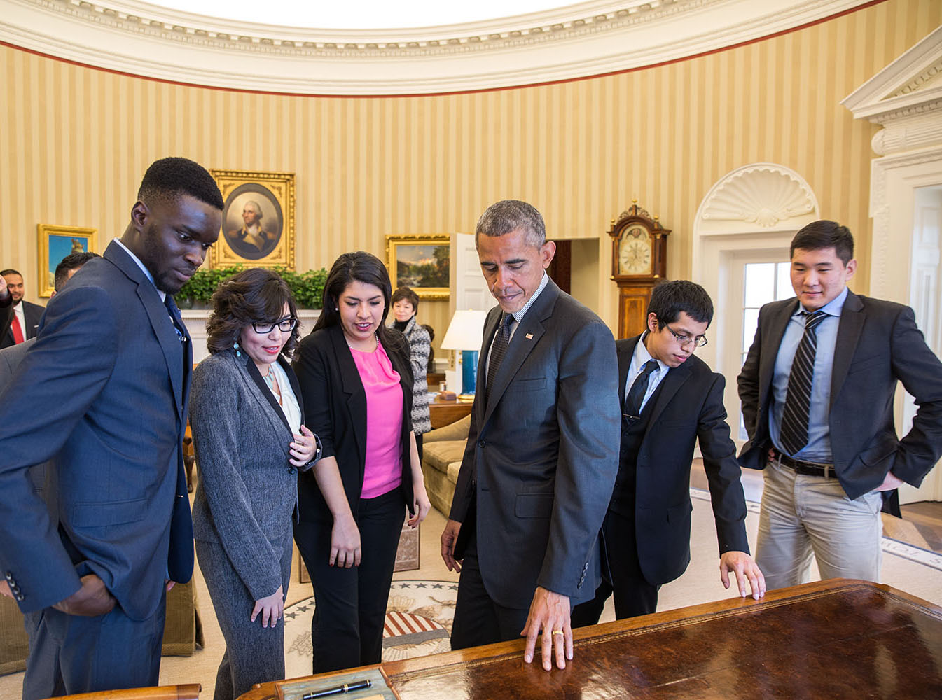 President Barack Obama shows the Resolute Desk in the Oval Office to a group of DREAMers, Feb. 4, 2015. (Official White House Photo by Pete Souza)
