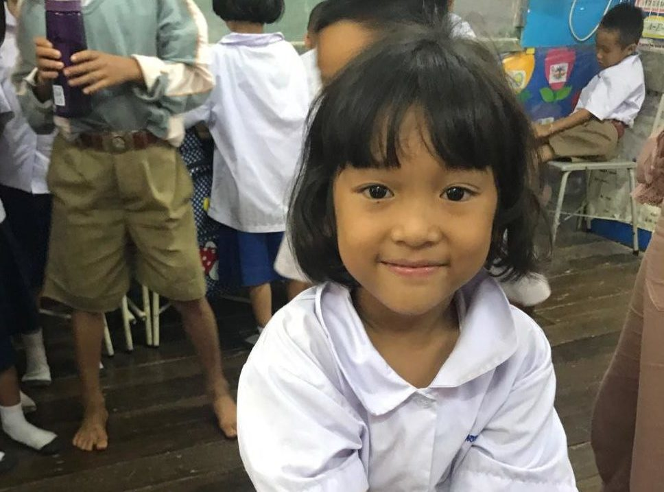 A little girl in my third grade class who had only seen a phone on TV, smiles for the camera. She is one of hundreds of students I taught English to during my 2017 trip to Thailand.