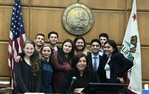 de Toledo's Mock Trial team competed at the Stanley Mosk Courthouse in Los Angeles Nov. 4 and 12. From left to right, with the Honorable Judge center: Ava W. '23, Sydney G. '20, Leah L. '20, Maddy M. '23, Benny G. '21, Shani H. '20 (back row) Spencer S. '21, Dylan S. '22, Ethan B. '23