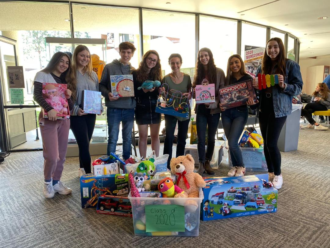 Club ACOA donated toys to Family Rescue Center and the books will be donated to Boys and Girls Club, both in our local communities. (Raquel Safdie, Advisor)