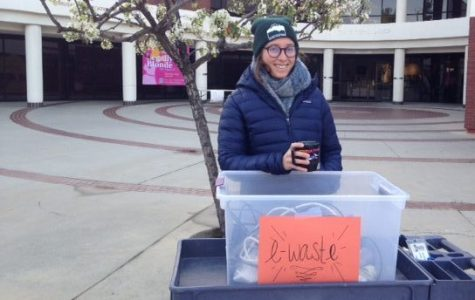 JOFFEE Fellow Stephanie Salem stands in the cold, collecting e-waste to be recycled.