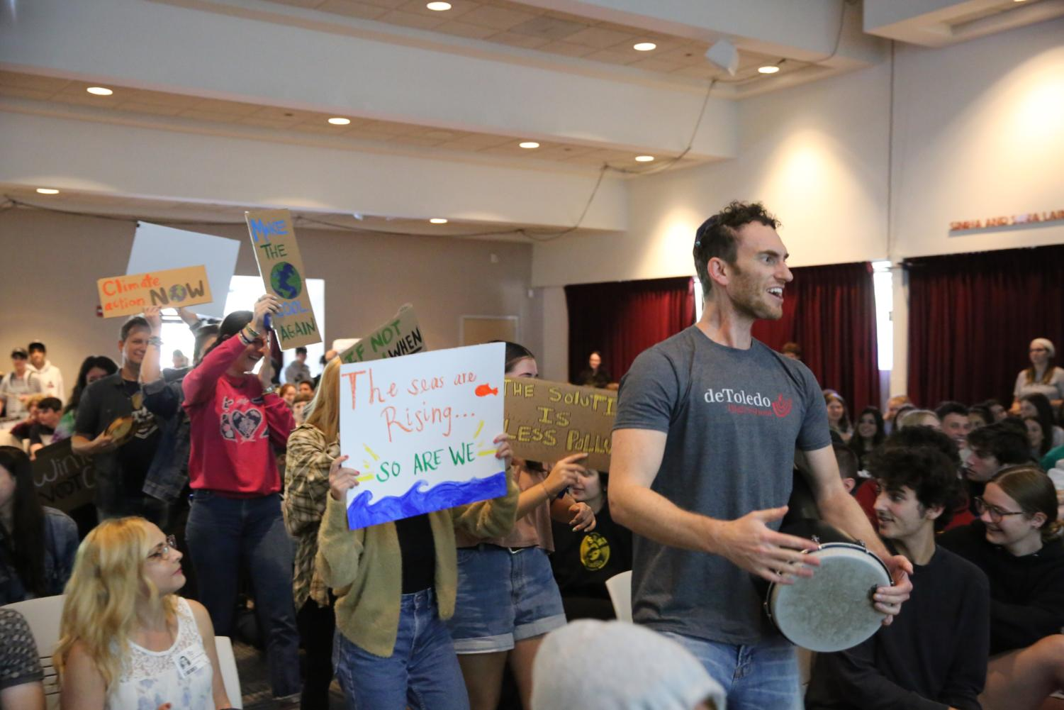 de Toledo students and faculty, including Rabbi Bubis on the drum, demonstrate the need for change before their peers at Town Hall.