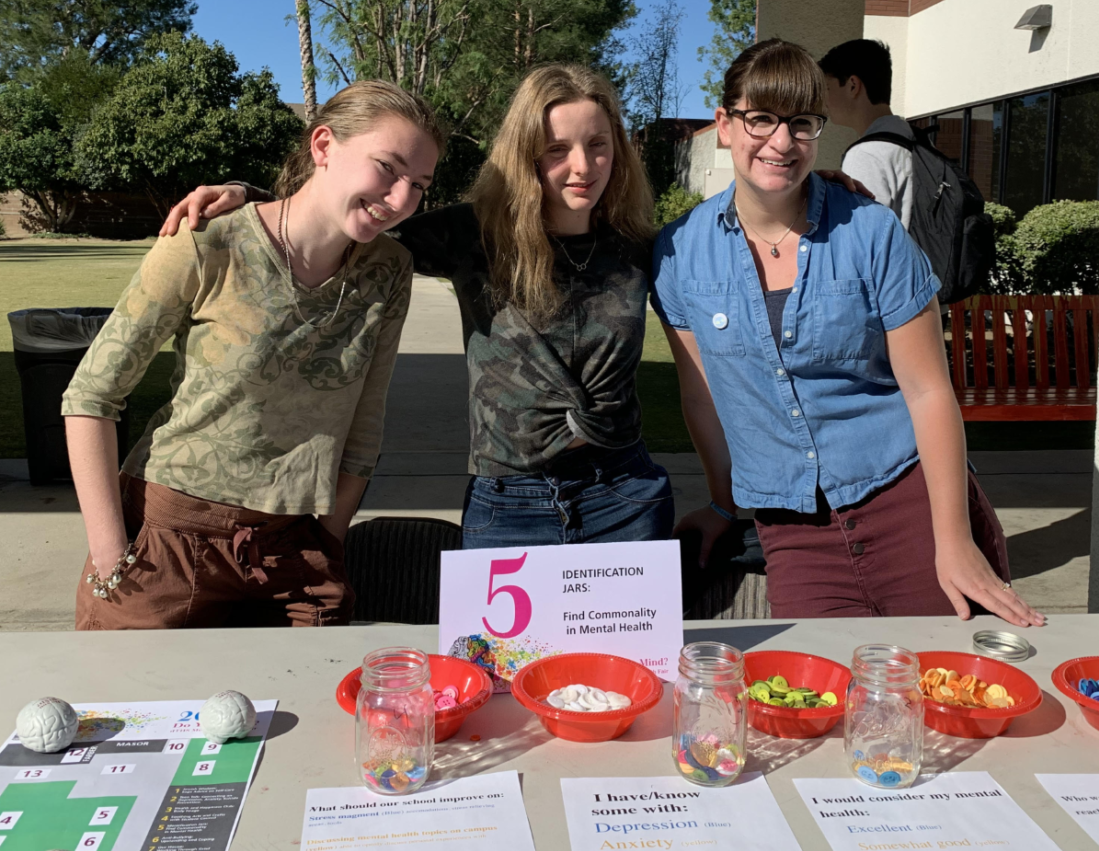 Left to right: Maya S. '20, Sydney G., '20 and deTOP teacher Zoe Fox  help students realize there are mental health problems all around us.