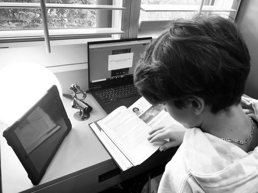 Sixth grade student Miles does his six hours of online school from home.